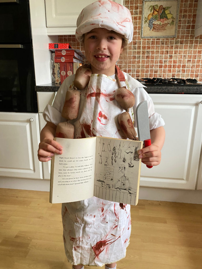 Emily gets in character to enjoy her book!